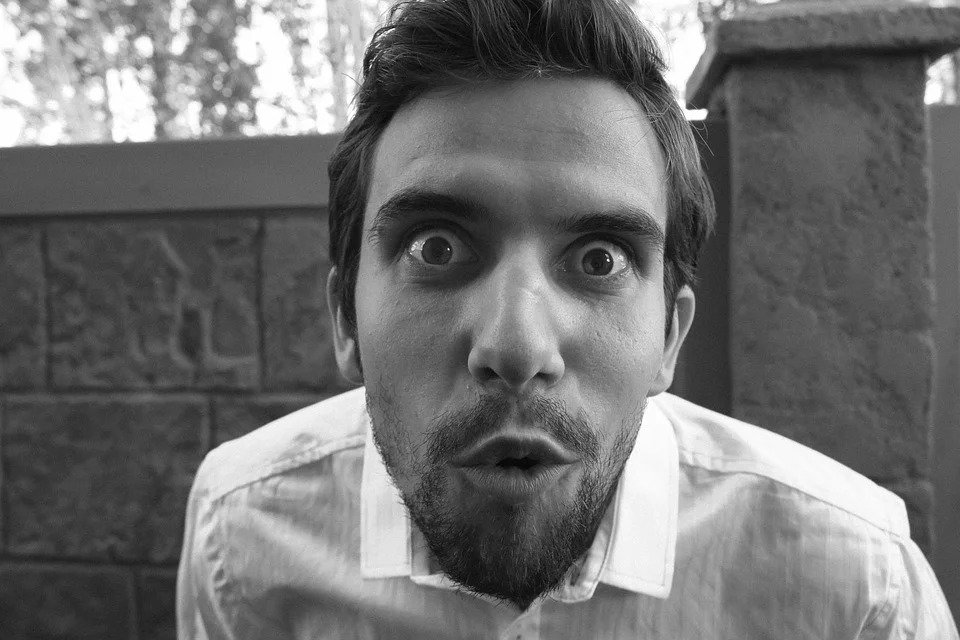 A man with a surprised expression.