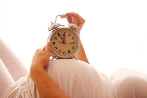 clock on pregnant woman