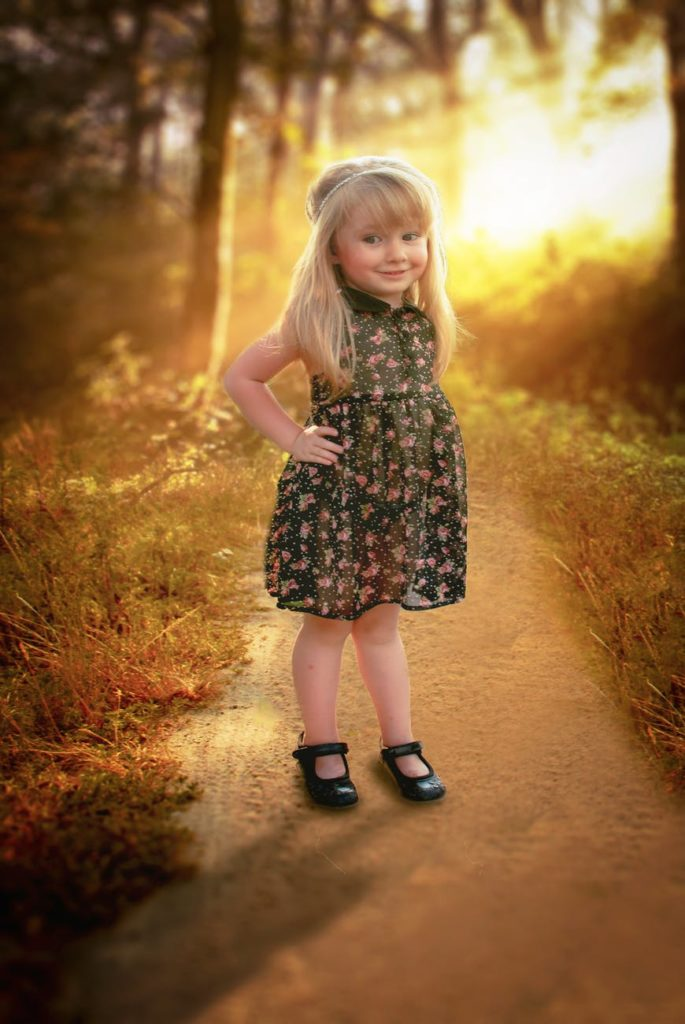 The daughter of the Intended Parent in a flowered dress.